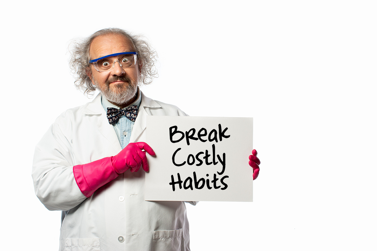 Scientist holds a sign with the words break costly habits.