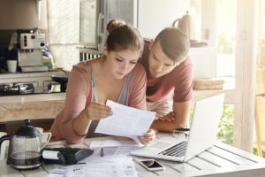 Couple reviewing their money management.